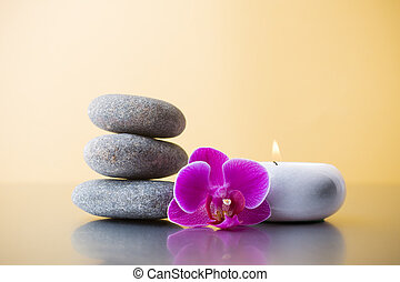 Spa stones. - Spa stones and green leaf, pink orchid on the...