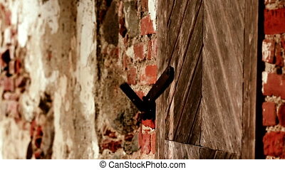 Brick wall and some wooden door the is widely open and some...