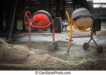 two pieces of cement mixer in an old factory