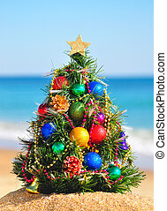 Christmas tree on the sand in the seashore - Christmas tree...