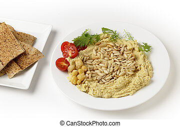 Lebanese hummus and pine nuts - Hummus and pine-nuts dip,...