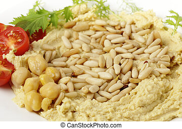 Hummus and pine nuts - Hummus and lightly roasted pine-nuts...