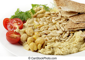 Lebanese hummus and pine nuts withoil - Lebanese hummus with...