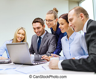 business team with laptop having discussion - business,...