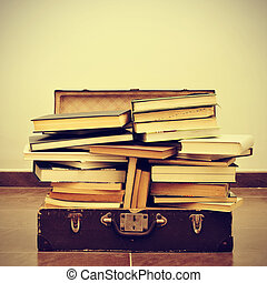 books in a suitcase - a pile of books in an old suitcase...
