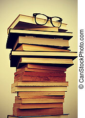 books and eyeglasses - a pile of books and eyeglasses...