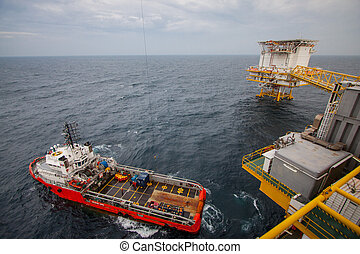 crane operation with supply boat. transfer cargo between the...