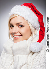 Girl in Santa hat Beautiful young woman in Santa hat looking...