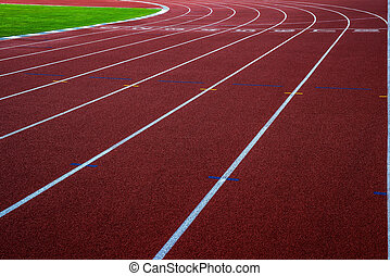 New running track with green grass, abstract, texture, background.