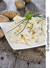 Portion of homemade Potato Salad with fresh herbs