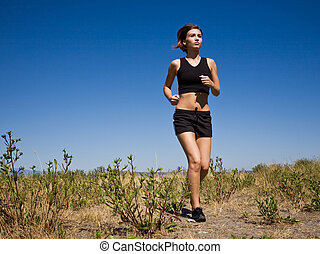 Running girl - A beautiful caucasian girl running on the...