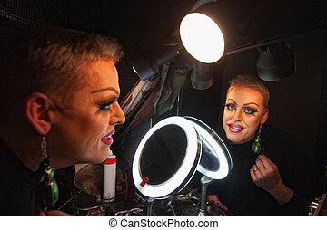 Drag Queen in Makeup Room - Caucasian drag queen at mirror...