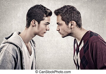 Upset men - Two young angry people standing face to face