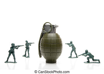 Soldiers and Hand Grenade - Several toy soldiers surrounding...