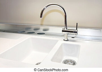 Sink - White sink and stainless still faucet in kitchen