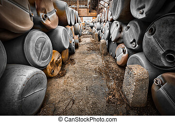 plastic barrels of toxic waste - many plastic barrels of...