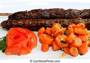 Grilled meat with carrots