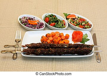 Grilled meat with carrots saute