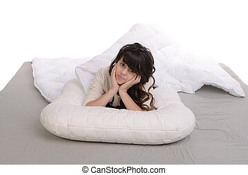 happy young girl lying on pillow