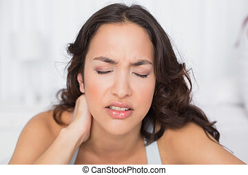 Woman suffering from neck pain with eyes closed - Close-up...