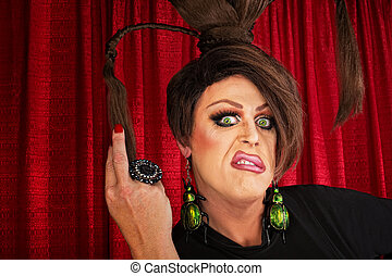Annoyed Drag Queen - Annoyed European drag queen pulling on...