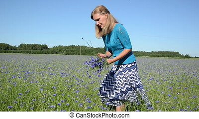 girl pick flowers - Turn view of attractive blond woman girl...