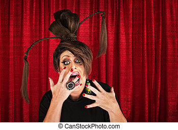 Scared Drag Queen - Shouting drag queen with ponytails with...