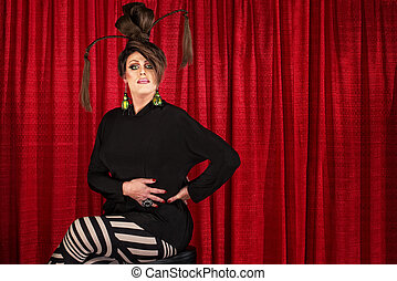 Serious Seated Man in Drag - Serious man in drag seated in...