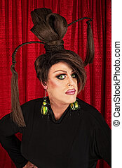 Serious Drag Queen in Black - Serious man in ponytails and...