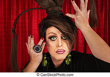 Dramatic Drag Queen - Big drag queen in theater fixing his...