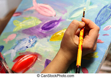 Artists hand with paintbrush painting the picture - Artists...