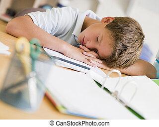 Young Boy Asleep On His Schoolbooks
