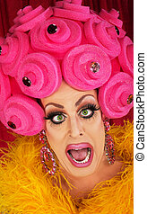 Drag Queen Yelling - Man in boa and pink foam wig yelling