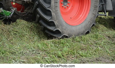 tractor collect hay field - Closeup special machine baler...