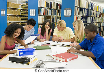 Six people in library studying