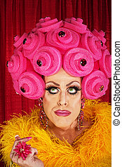 Thinking Drag Queen - Serious man in drag with yellow boa...