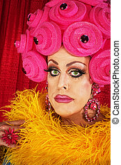 Man in Pink Foam Wig - Serious man in yellow boa and pink...