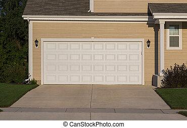 garage door - double white wooden garage door in a detached...