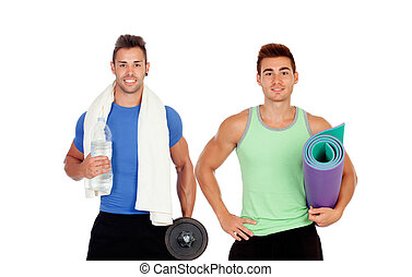 Two muscular men with gym equipment isolated on a white...
