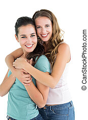 Side view portrait of a female embracing her friend - Side...