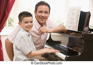 hombre, joven, niño, juego, piano, sonriente