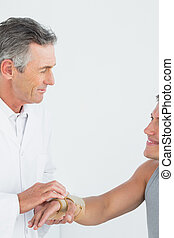 Male doctor examining a patients ha