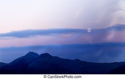 Moon rised and shining over the high mountain