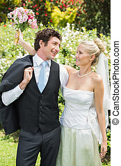 Romantic newlywed couple smiling at each other