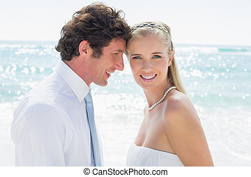 Happy couple on their wedding day at the beach
