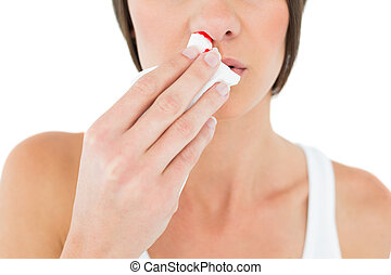Close-up mid section of a woman with bleeding nose -...