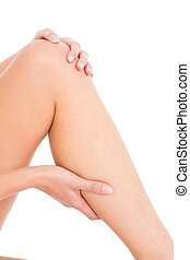 Close-up mid section of a woman with leg pain - Close-up mid...
