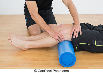 Man getting his knee examined by a physical therapist - Low...