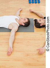 Physical therapist and man relaxing with eyes closed -...