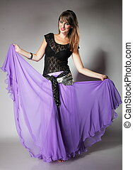 Beautiful exotic belly dancer woman dancing girl studio shot...